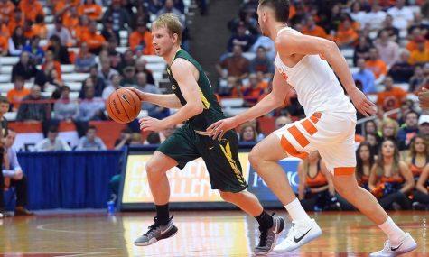 Men's Basketball Beats LIU Post, Falls to Top Team in Country over Break