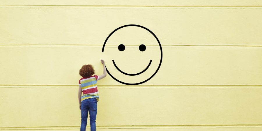 Girl+drawing+smiley+face+on+to+a+wall