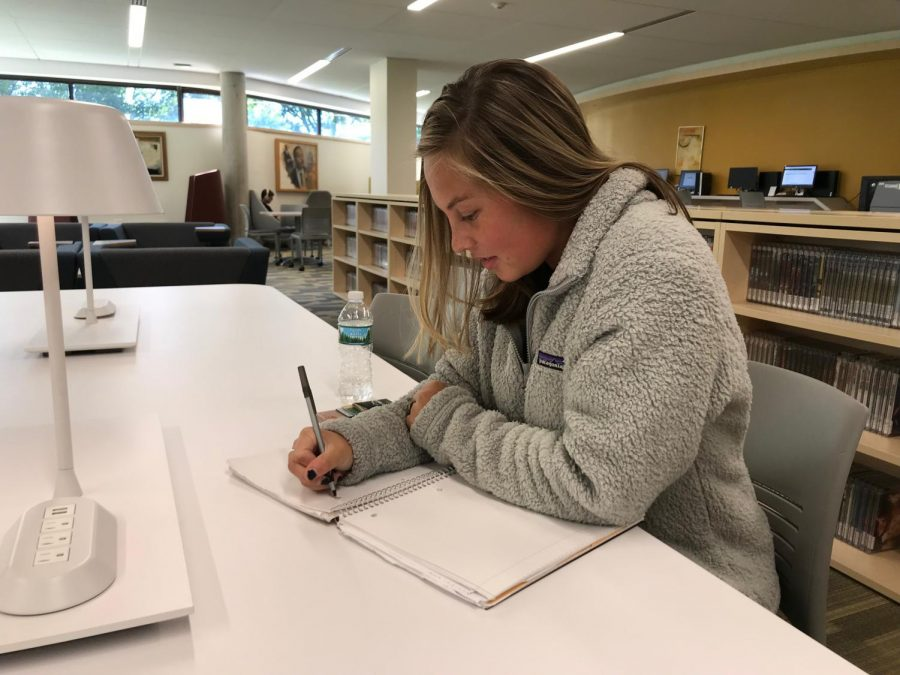 Sarah+Buck%2C+first-year+Biology+student+and+Promise+NY+scholarship+recipient%2C+does+homework+in+the+library+on+Thursday%2C+Oct.+18.