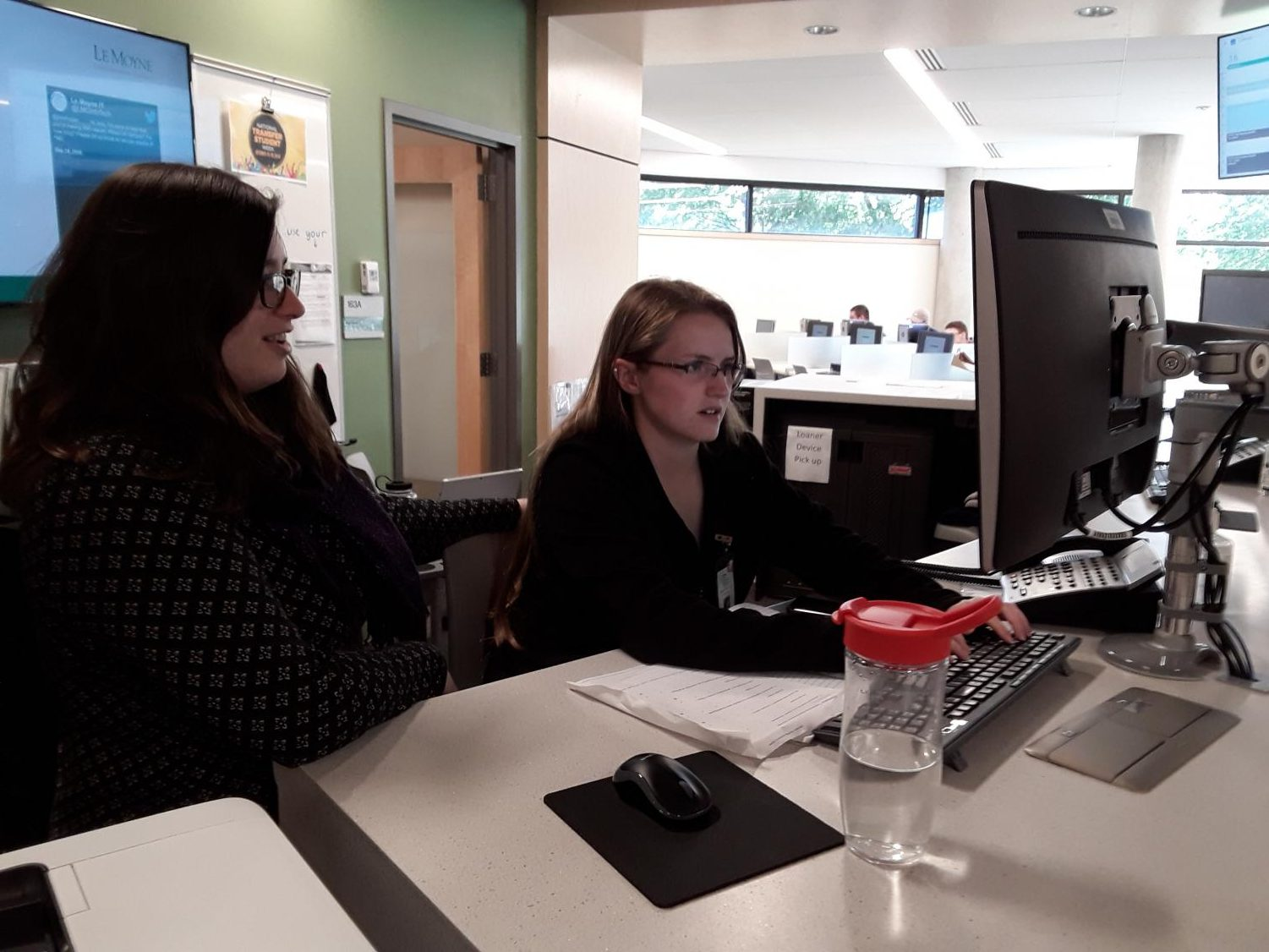 IT staff members Ranata De Gennaro (left) and Kassandra Neff work in the Noreen Falcone library.