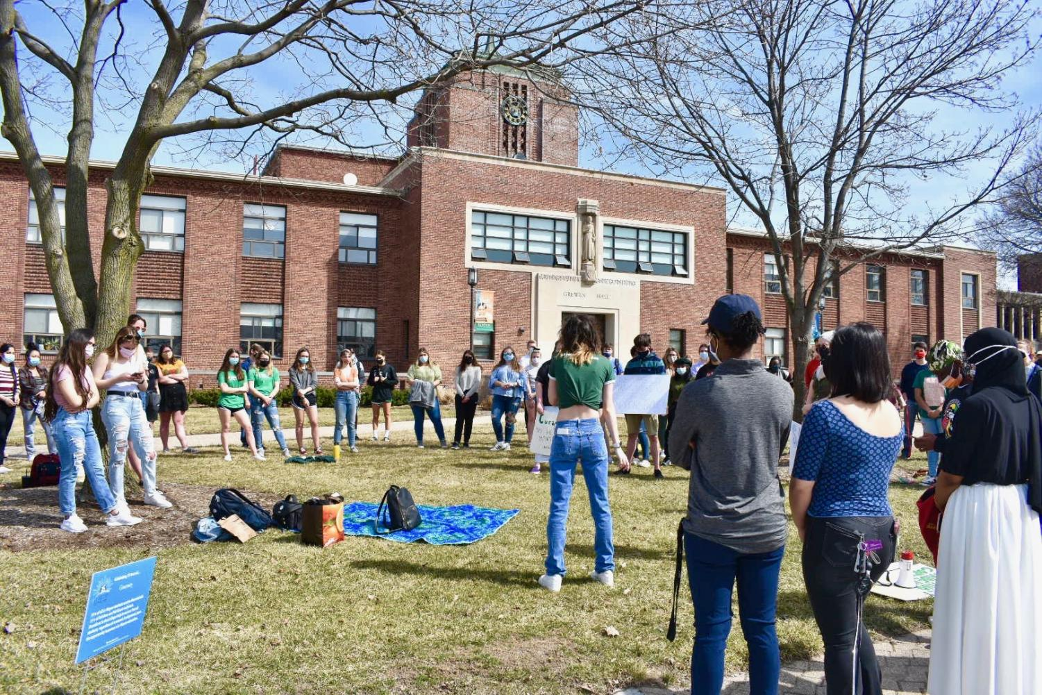 Students protest outside Grewen Hall [Photo by Olivia Poust]
